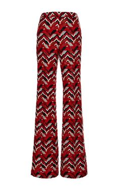 For pre-fall '15, **Giambattista Valli** infused his flourishing feminine designs with shades of the psychedelic, lending a sense of boho chic to his signature polished aesthetic. Lengthen the legs with these Giambattista Valli wide leg pants, cast in a vibrant red embroidered chevron. The resulting look, both sophisticated and vibrant, gives a nod to the retro but in a thoroughly modern way.