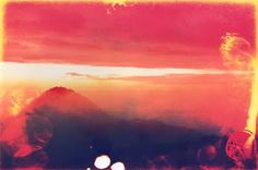 burned, bleached, damaged found photographs of sunsets. beautiful. eric william carroll