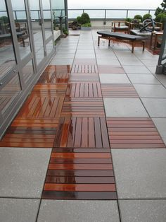 concrete pavers and wood decking at the Kips Bay Showhouse in NYC// This is exactly what I have been looking for!!!! This will be done at my house in my outdoor room. It has been a bare patch of dirt waiting for me to do something!! Viola here it is!! I love this!!! and it will be done.......