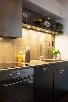 chic apartment with a modern design in sweden black kitchen island in swedish attic apartment - Magenta Kitchen Design