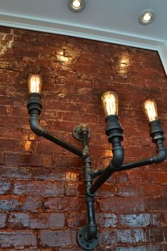 Triple Industrial Pipe Wall Light by WestNinthVintage on Etsy, $233.00 I HAVE FALLING IN LOVE WITH THESE PIPE LIGHTS....