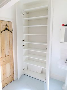 PAX Wardrobe assembled in bathroom bromley showing shelves