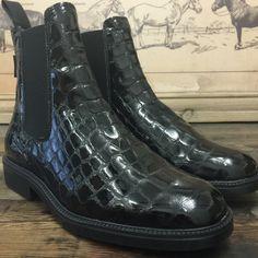 Avventura in faux black croc high gloss leather.
