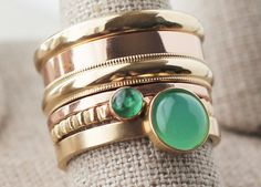 14k rose and yellow gold ring stack with an Emerald and a Chrysoprase