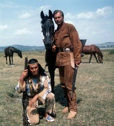 Winnetou (Pierre Brice, L), Chief of the Apache Indians, and his white-skin friend Old Shatterhand (Lex Barker) are the heroes of films based on the German western novels by Karl May, pictured in a movie scene from the episode'Im Tal des Todes (In the death valley), 1968.