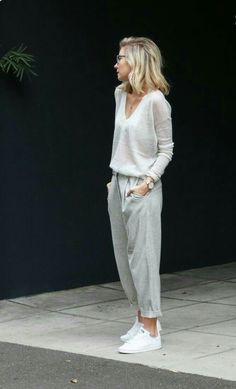 Long sleeved v-neck translucent cashmere sweater in a color somewhere  between white and gray paired with gray trouser style ankle grazer pants  rolled to a ... 83c3ddf36d8c