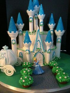 Cinderellas Casltle - Used the Wilton set. Carriage is made of Rice Crispies. Rose bushes are mini cupcakes. Flowers made from fondant. I used candy melts for the turrets. It took a LONG time to put it all together but I'm happy with the outcome.