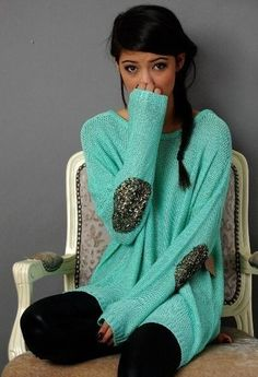 Turquoise sweater with glittery elbow patches.