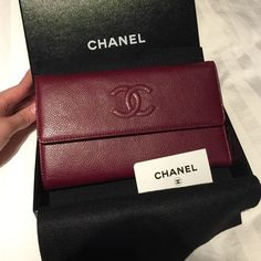 authentic Chanel L flap wallet in burgundy color. Rare color!! New never used. I have no use for this baby so I'm selling it. 100% authentic. Come with box , Chanel tag, saks fifth avenue tag and authenticity card. Sorry no receipts. CHANEL Bags Wallets