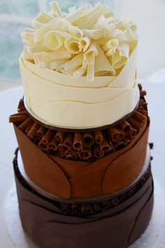 Nice 3-tired chocolate wedding cake by Coco Jo Cake Design.