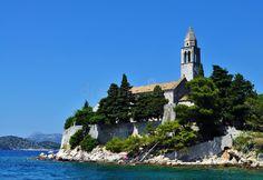 Photo about Photo of a church by the sea - Lopud Island - Elaphiti Islands - Dubrovnik - Croatia - July 2010. Image of croatia, church, boat - 113007044