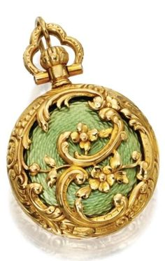 18 Karat Gold and Enamel Pendant-Watch, Tiffany & Co., Circa 1900. The white porcelain circular dial with blue Arabic numerals and baton markers, within a gold case, the reverse of floral design applied with pale yellowish-green guilloché enamel, manual movement, dial signed Tiffany & Co. New York, jewelled movement signed Tiffany & Co., New York, numbered, French assay marks and partial maker's mark. #Tiffany #antique #watch