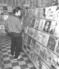 Elvis browses the hits at a Memphis record store in 1957