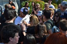 Montana's Jeff Ament signs autographs for fans at the University of Montana