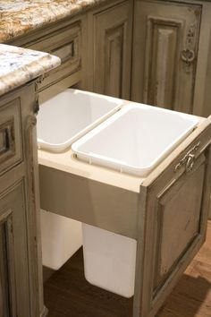 Habersham Custom Kitchen Cabinetry. Would be good for recycling bins