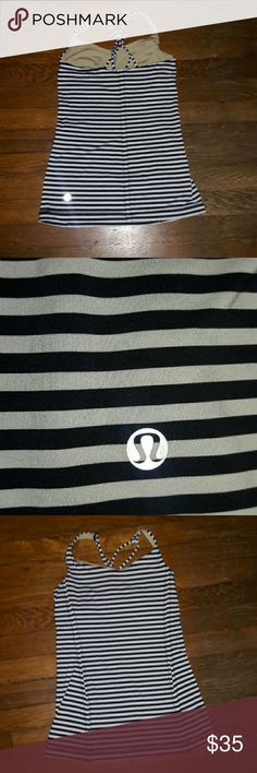 Lululemon Strappy Tank Has a shelf bra built into it. Their is no size on the inside and I'm not sure what size it is when I originally bought it. Will fit a small/meduim. lululemon athletica Tops Tank Tops