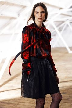 Quilted leather circle skirt, floral based large black tie neck silk blouse and fishnets are an easy closet In for Fall from Preen Line.