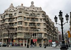 "Casa Milà, better known as La Pedrera (""the quarry"" in English) designed by the Catalan architect Antoni Gaudí. It is located at 92, Passeig de Gràcia (passeig is Catalan for promenade) in the Eixample district of Barcelona, Catalonia, Spain."