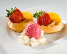 Mini waffle with strawberry, peaches and whipped cream