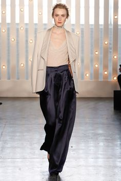 Jenny Packham. Pulling off a palazzo pant requires an easy laid back attitude. And equally as simple and draped tops.