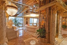 Lap of luxury: Donald and Melania Trump's New York City penthouse is on the 66th floor of Trump Tower and features marble walls, floors and columns throughout. 24-carat gold accents like platters, lamps, vases and crown molding that outlines each room and tableau ceilings