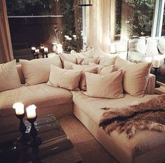Essentially, this is the kind of sitting room I want. Deep couches with lots of pillows in neutral colors!