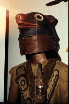 Mannequin donning painting leather vest, double-edged dagger, and war helmet in the image of sea lion.