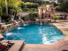 pool with waterfalls modern patio palm trees pergola fireplace dining area