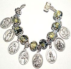 $129 Murano glass lampwork sterling silver Catholic charm bracelet - THE MEDALS / CHARMS ARE AS FOLLOWS:   (1) HOLY TRINITY/PRAY FOR US;   (2) HEART & CROWN OF THORNS/INFANT OF PRAGUE;   (3) SACRED HEART OF JESUS/SACRED HEART OF MARY;   (4)ST. CHRISTOPHER/PRAY FOR US;   (5) ST. ANN & CHILD VIRGIN MARY/PRAY FOR US;   (6) ST. BERNADETTE/LOURDES GROTTO;   (7) ST.JOSEPH/PRAY FOR US;   (8) HOLY FAMILY/GUARDIAN ANGEL