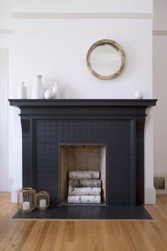 Decorating Ideas: 5 Ways Black Tiles Can Look Amazing at Home | Apartment Therapy Black Grout, Black Tiles, Black Fireplace Mantels, Fireplace Hearth Tiles, Subway Tile Fireplace, White Painted Fireplace, Painted Fireplaces, Faux Mantle, Mantles