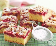This gorgeous dessert is a flavour and texture sensation that will delight your friends and family. A sweet, gooey raspberry topping sits beautifully atop a fluffy, vanilla slice. Add a crumbly, almond topping for extra crunch. Best Rocky Road Recipe, My Favorite Food, Favorite Recipes, Afternoon Tea Recipes, Savory Scones, Cafe Food, Almond Recipes, Gluten Free Baking, No Bake Cake