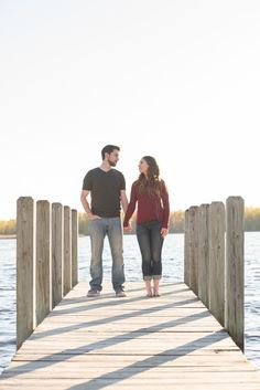 Engagement photos at sunset on the lake. Pose ideas and pic by Awakened Light Photography, Michigan.