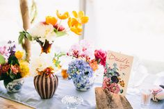 Colourful mixed centrepieces | SouthBound Bride | http://www.southboundbride.com/vintage-floral-farm-wedding-by-cari-photography-rieke-jurgens | Credit: Cari Photography
