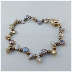 Made in the workshop, Organic Pearl with Silver & Gold Plated Shell Clasp.