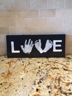 DIY LOVE sign. Made with son's hand and daughter's feet. Great gift for grandma!!!