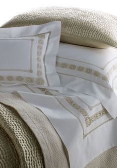 A Jour: This richly-detailed Egyptian cotton bed set features a hand-embroidered crochet-like design in ivory, our softest woven cotton blanket and a coordinating silk Charmeuse coverlet in an all-over Hammered Silver pattern.