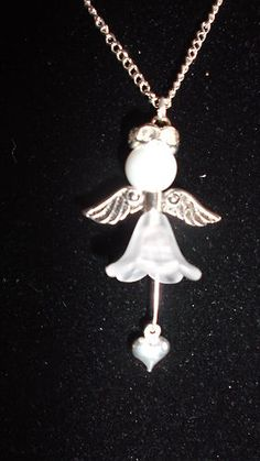 Guardian Angel pearl and heart pendant. In memory of a loved one