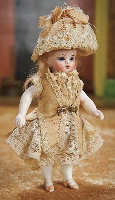 """Theriault's - 6"""" Petite German All-Bisque Doll with Very Fine Original Costume, c 1885"""