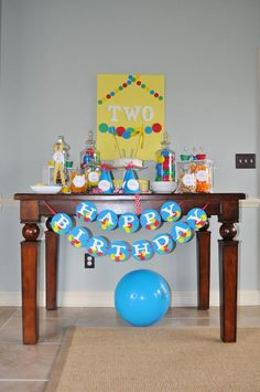 Ball Toy Circle Themed Boy 2nd Birthday Party Planning Ideas.       I like the colors of this party