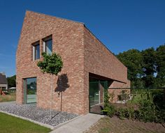Home in Belgium by Joris Verhoeven features handmade bricks and a lopsided roof