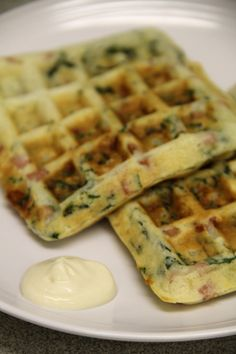 Ham, Asiago, and spinach waffles with a creamy Dijon sauce. Sure, as a vegetarian I'd have to choose something other than ham - but the idea is fantastic.