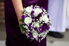 Purple bridesmaids flowers by Manchester wedding photographer riclatham.com
