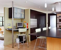 color variety, island counter top overhang, kitchen workspace with a hint of stainless steel