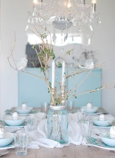 Like this mason jar idea for the centerpieces. Vintage country look of the mason jars with a modern arrangement.