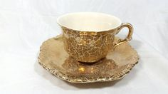 Check out this item in my Etsy shop https://www.etsy.com/listing/234592553/vintage-gold-crackled-teacup-and
