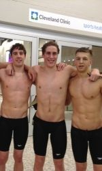 Jordan Sharples (right) swims for GW from Manchester, England. This photo was taken right after finishing the 500 yard freestyle at the Atlantic 10 championships with seniors Stephen Nelson (left) and Niklas Glenesk (middle).