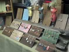 Such a simple but nice jewelry Craft show display! The uniformity is clean and simple and the wood display pieces would be easy to make.