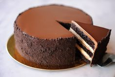 A great chocolate cake goes like this: Start with a layer of devil's food cake, nearly obsidian dark from Valrhona cocoa powder. Then add a thick strata of buttercream, another of chocolate crémeux, more cream, more Valrhona. Then more of the same, building up, layer by layer, like chocolate architecture. ...