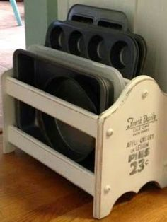 pink petunia pearl: New Year New Orgainzation ~ Genius Double-Duty Organizing Ideas Magazine Rack ~ A bit of chalk paint turned this wooden organizer into a shabby-chic place for pans that's totally worthy of a spot on a countertop.