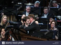 Moscow, Russia. 22nd Nov, 2019. MOSCOW, RUSSIA - NOVEMBER 22, 2019: French pianist Alexandre Kantorow (L) and Russian conductor Alexander Sladkovsky during a gala concert at the 15th Crescendo Music Festival in the Large Hall of Zaryadye Concert Hall. Sergei Karpukhin/TASS Credit: ITAR-TASS News Agency/Alamy Live News Stock Photo News Agency, Moscow Russia, Live News, Concert Hall, Conductors, November, French, Stock Photos, Music